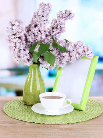 Beautiful lilac flowers on table in room Stock Photo - 21013713