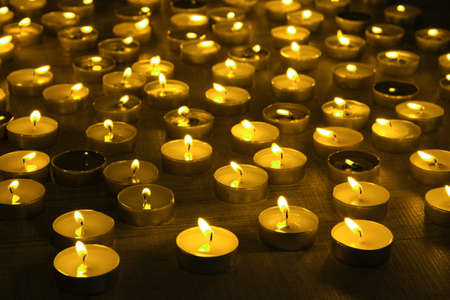 candlelight memorial: Burning candles on dark background