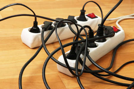 Overloaded power boards, close up Stock Photo - 21034098