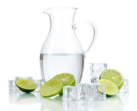 Glass pitcher of water with ice and lime isolated on white Stock Photo - 21034687