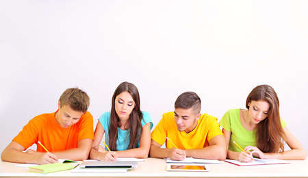 Group of young students sitting in the room Stock Photo - 21219836