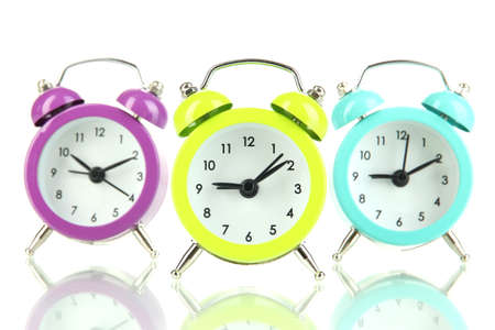 Retro alarm clocks, isolated on white photo