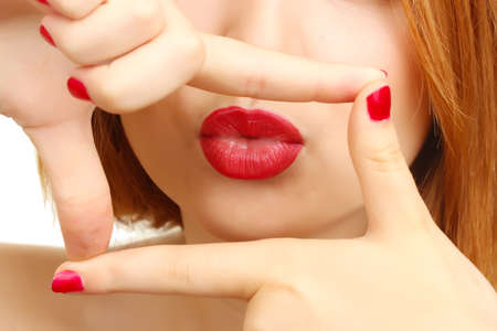 beautiful make up of glamour red gloss lips and red  manicure photo