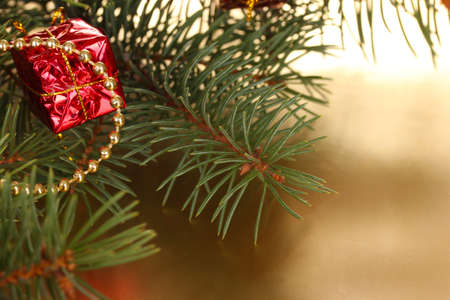 Christmas tree with beautiful gift on table photo