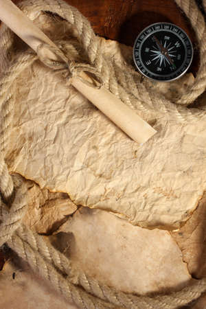 old paper, compass and rope on a wooden table photo