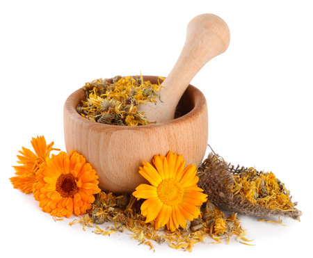 Fresh and dried calendula flowers in wooden mortar  isolated on white Stock Photo - 21093505