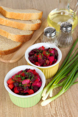 Beet salad in bowls on table close-up photo