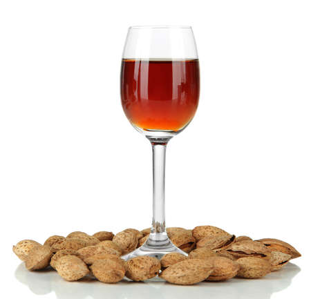 Glass of amaretto liquor and roasted almonds, isolated on white Stock Photo