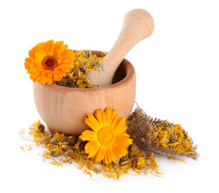 Fresh and dried calendula flowers in wooden mortar  isolated on white Stock Photo - 21112366