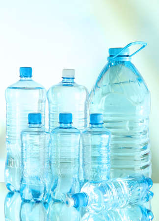 Water in different bottles on light background Stock Photo - 21112529