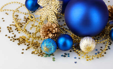 beautiful blue Christmas balls and cone isolated on white photo
