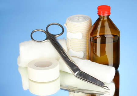 First aid kit for bandaging on blue background Stock Photo - 21112751