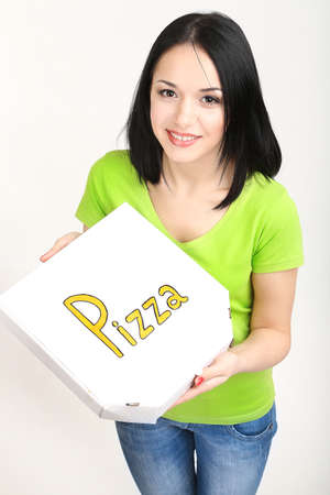 Beautiful girl with pizza in pizza box isolated on white photo