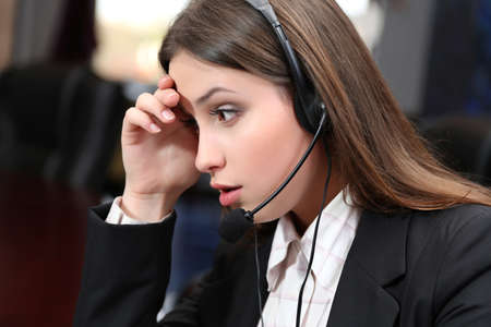 Call center operator at work  photo