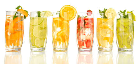 iced tea: Glasses of fruit drinks with ice cubes isolated on white