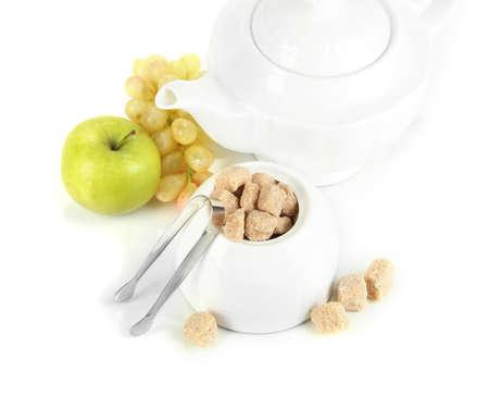 unrefined: Unrefined sugar in white sugar bowl on grey background Stock Photo