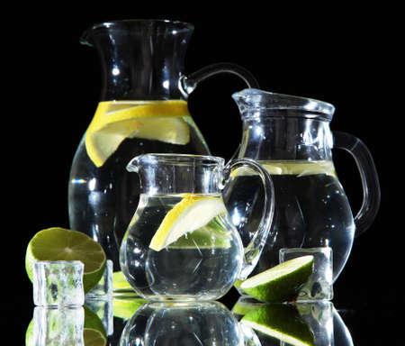 Glass pitchers of water isolated on black Stock Photo - 21113101