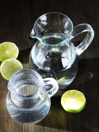 Glass pitchers of water on wooden table close-up Stock Photo - 21113102