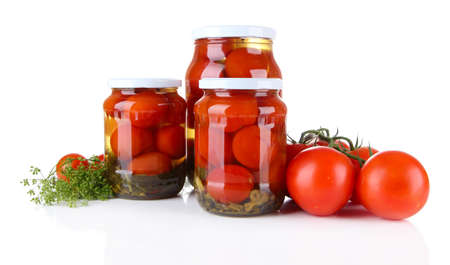 Tasty canned and fresh tomatoes, isolated on white photo