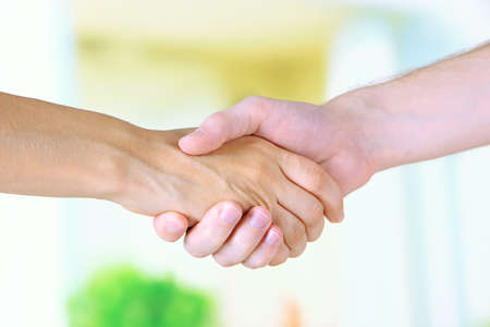 Handshake on light background photo