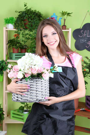 Beautiful girl florist with flowers in flowers shop Stock Photo - 21203986