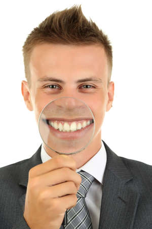 zooming: Businessman with magnifying glass zooming on his smile Stock Photo