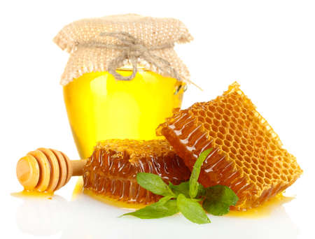 sweet honeycombs, jar with honey and flowers, isolated on white photo
