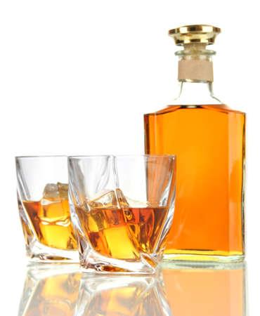 whisky bottle: Glasses of whiskey with bottle, isolated on white