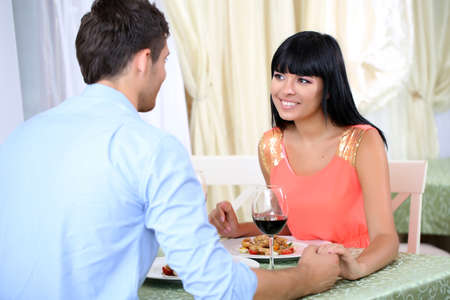 Beautiful couple having  romantic dinner at restaurant photo