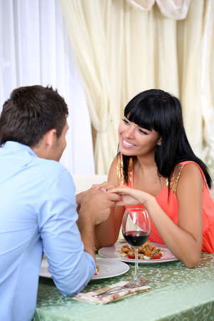 romantic dinner: Beautiful couple having  romantic dinner at restaurant Stock Photo