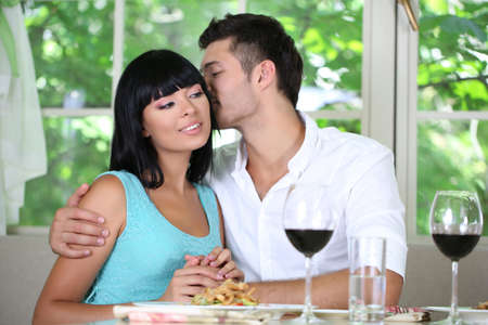 Beautiful young couple at restaurant Stock Photo - 21553620