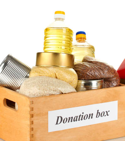 Donation box with food on white background close-up photo