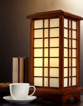 Japanese table lamp on brown background photo