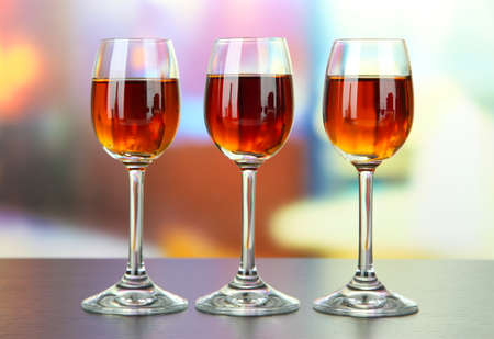 amaretto: Glass of amaretto liquor, on bright background