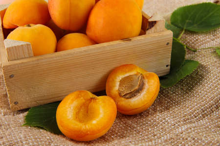 bagging: Apricots in drawer on bagging on wooden table Stock Photo