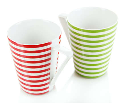 Cups on grey background photo