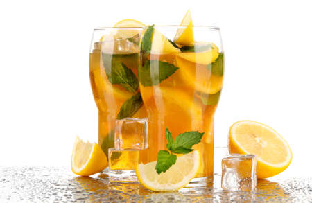 Iced tea with lemon and mint isolated on white photo