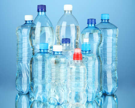 Bottles of water, on blue background photo