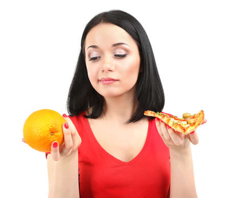 Pretty girl selects pizza or diet isolated on white photo