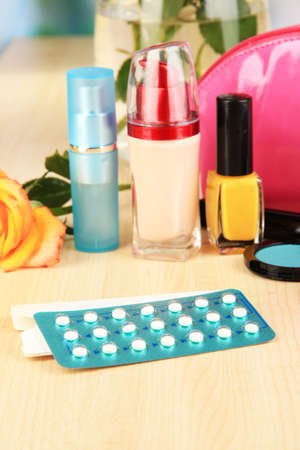 hormonal: Hormonal pills in womens bedside table on room background Stock Photo