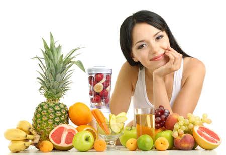 Girl with fresh fruits isolated on white photo