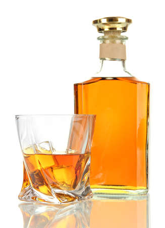 Glass of whiskey with bottle, isolated on white photo