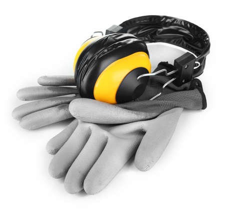 onslaught: Protective gloves and headphones isolated on white