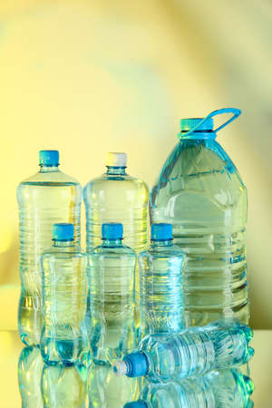 purified: Water in different bottles on light background Stock Photo