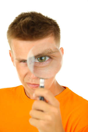 Young man looking through magnifying glass, isolated on white photo