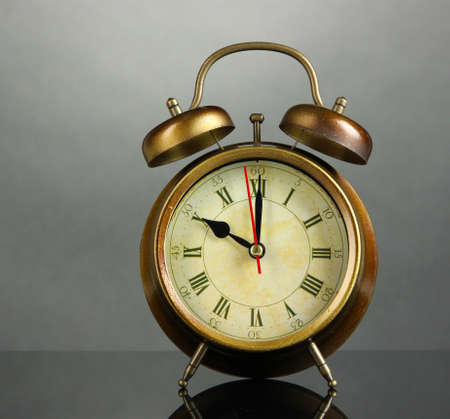 Old alarm clock  on gray background photo