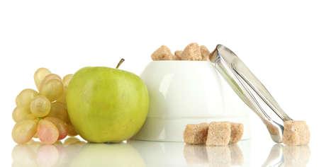 unrefined: Unrefined sugar in white sugar bowl on white background Stock Photo
