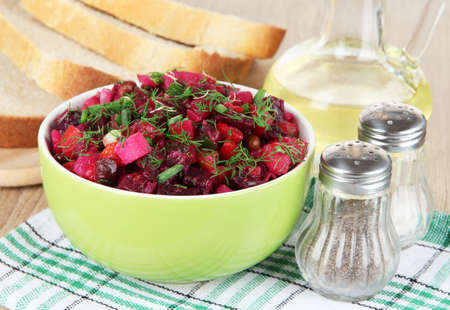 Beet salad in bowl on table close-up photo