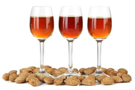 amaretto: Glasses of amaretto liquor and roasted almonds, isolated on white Stock Photo
