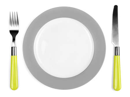 Knife, white plate and fork, isolated on white photo